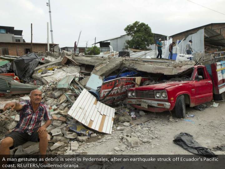 A man gestures as debris is seen in Pedernales, after an earthquake struck off Ecuador's Pacific coast. REUTERS/Guillermo Granja