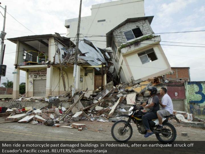 Men ride a motorcycle past damaged buildings in Pedernales, after an earthquake struck off Ecuador's Pacific coast. REUTERS/Guillermo Granja