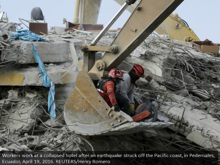 Workers work at a collapsed hotel after an earthquake struck off the Pacific coast, in Pedernales, Ecuador, April 19, 2016. REUTERS/Henry Romero