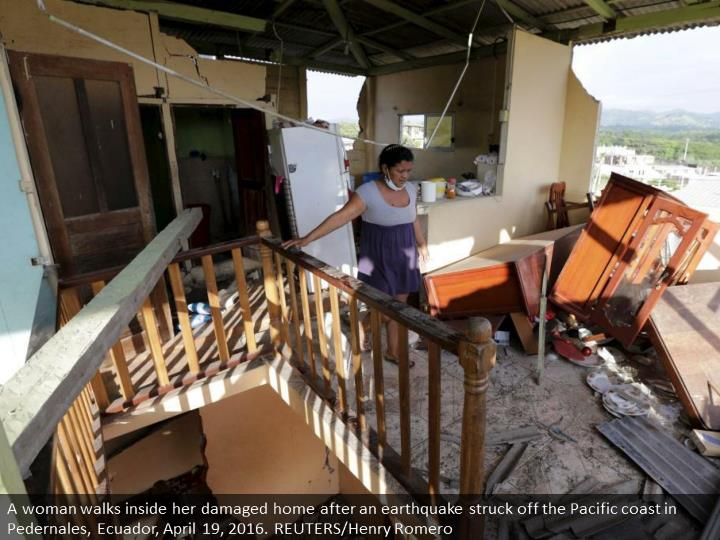 A woman walks inside her damaged home after an earthquake struck off the Pacific coast in Pedernales, Ecuador, April 19, 2016. REUTERS/Henry Romero