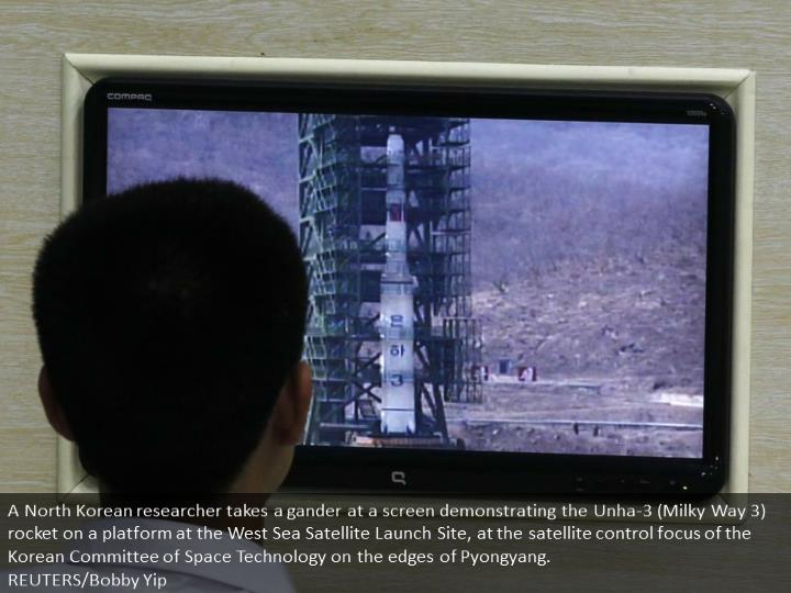 A North Korean scientist looks at a monitor showing the Unha-3 (Milky Way 3) rocket on a launch pad at the West Sea Satellite Launch Site, at the satellite control centre of the Korean Committee of Space Technology on the outskirts of Pyongyang.  REUTERS/Bobby Yip