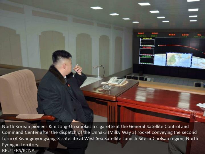 North Korean leader Kim Jong-Un smokes a cigarette at the General Satellite Control and Command Center after the launch of the Unha-3 (Milky Way 3) rocket carrying the second version of Kwangmyongsong-3 satellite at West Sea Satellite Launch Site in Cholsan county, North Pyongan province.  REUTERS/KCNA