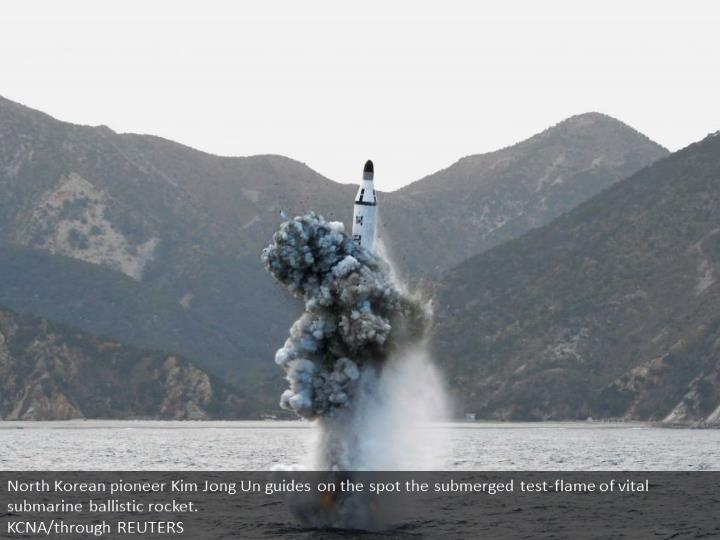 North Korean leader Kim Jong Un guides on the spot the underwater test-fire of strategic submarine ballistic missile.  KCNA/via REUTERS