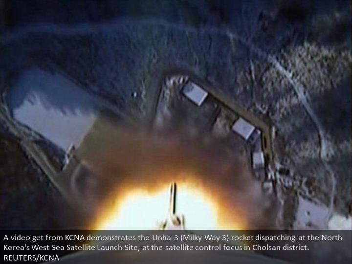 A video grab from KCNA shows the Unha-3 (Milky Way 3) rocket launching at the North Korea's West Sea Satellite Launch Site, at the satellite control centre in Cholsan county. REUTERS/KCNA