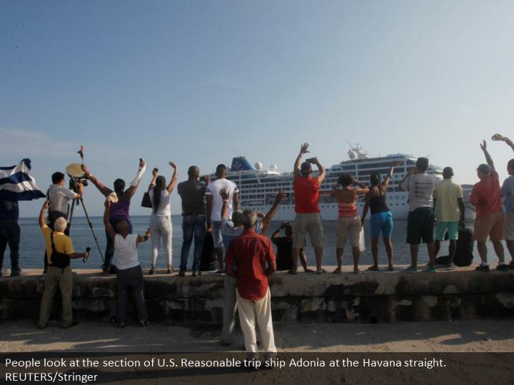People look at the arrival of U.S. Carnival cruise ship Adonia at the Havana bay. REUTERS/Stringer