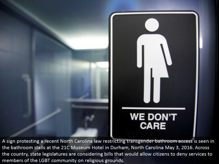 A sign dissenting a late North Carolina law limiting transgender restroom access is found in the lav...