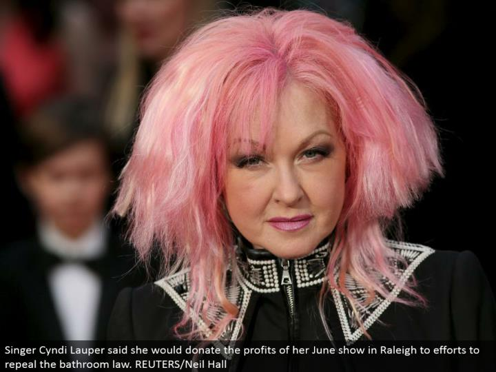 Singer Cyndi Lauper said she would give the benefits of her June show in Raleigh to endeavors to revoke the restroom law. REUTERS/Neil Hall