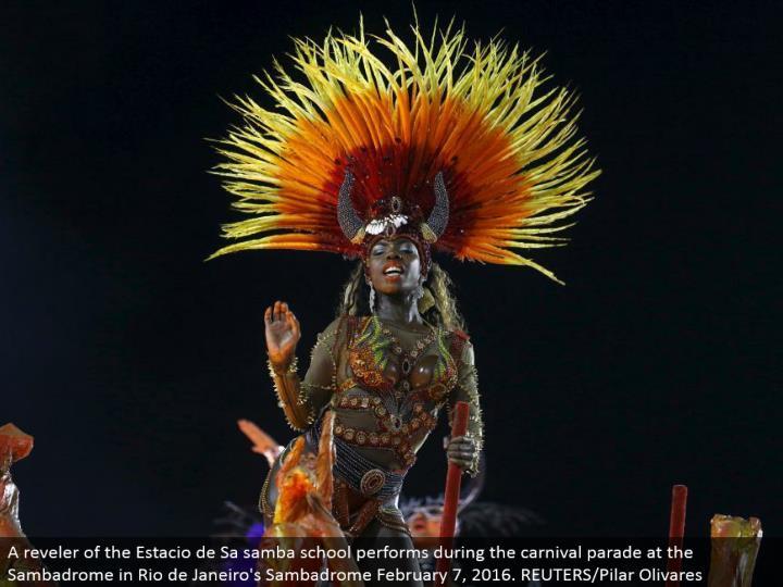 A reveler of the Estacio de Sa samba school performs amid the festival parade at the Sambadrome in Rio de Janeiro's Sambadrome February 7, 2016. REUTERS/Pilar Olivares