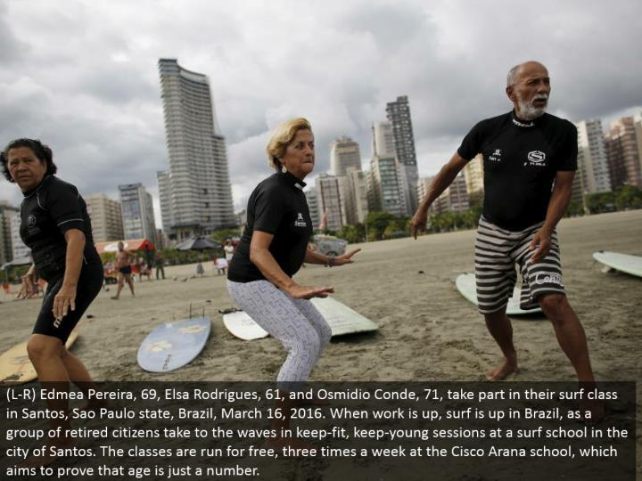 (L-R) Edmea Pereira, 69, Elsa Rodrigues, 61, and Osmidio Conde, 71, join in their surf class in Sant...