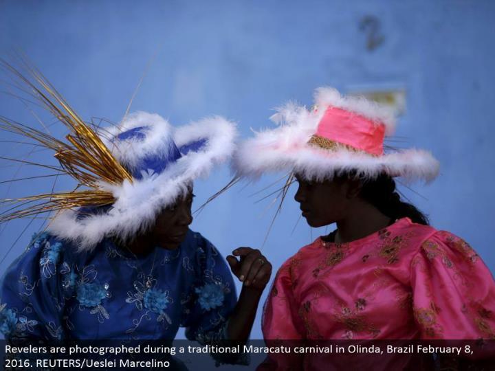 Revelers are shot amid a conventional Maracatu fair in Olinda, Brazil February 8, 2016. REUTERS/Ueslei Marcelino