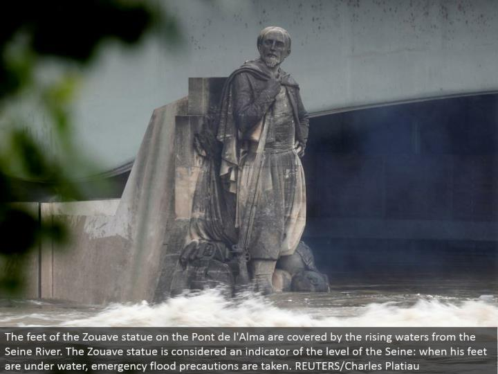 The feet of the Zouave statue on the Pont de l'Alma are secured by the rising waters from the Seine River. The Zouave statue is viewed as a pointer of the level of the Seine: when his feet are submerged, crisis surge safety measures are taken. REUTERS/Charles Platiau