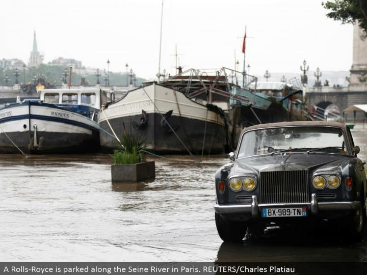 A Rolls-Royce is stopped along the Seine River in Paris. REUTERS/Charles Platiau