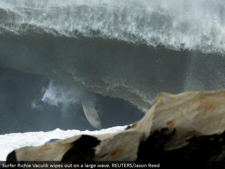 Surfer Richie Vaculik wipes out on an expansive wave. REUTERS/Jason Reed