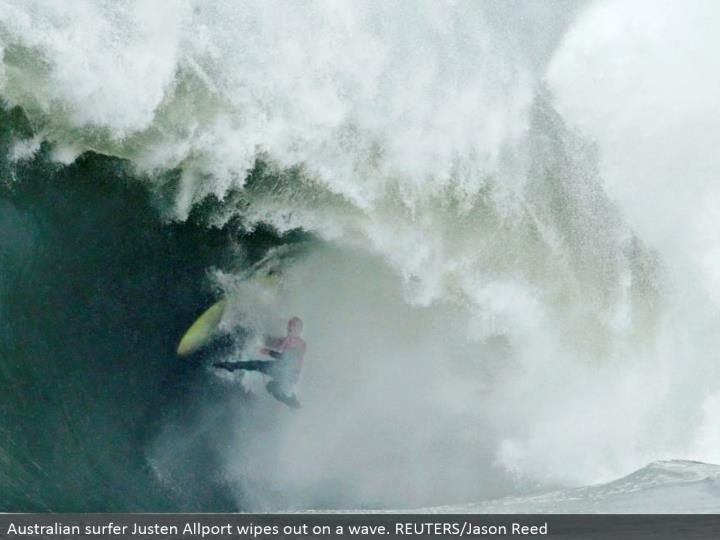 Australian surfer Justen Allport wipes out on a wave. REUTERS/Jason Reed