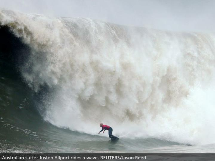 Australian surfer Justen Allport rides a wave. REUTERS/Jason Reed