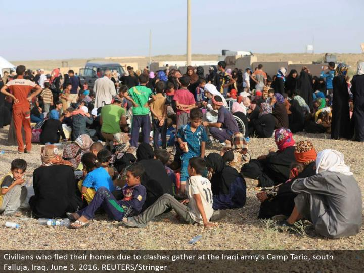 Civilians who fled their homes because of conflicts accumulate at the Iraqi armed force's Camp Tariq, south Falluja, Iraq, June 3, 2016. REUTERS/Stringer