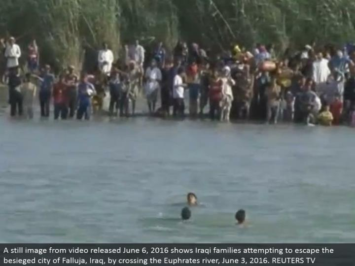 A still picture from video discharged June 6, 2016 shows Iraqi families endeavoring to get away from the assaulted city of Falluja, Iraq, by intersection the Euphrates stream, June 3, 2016. REUTERS TV