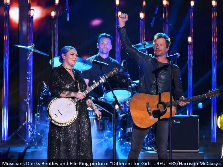 "Musicians Dierks Bentley and Elle King perform ""Diverse for Girls"". REUTERS/Harrison McClary"