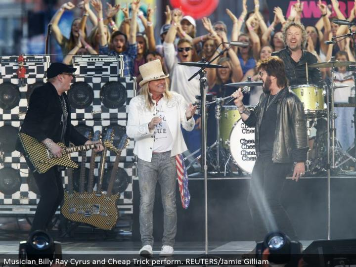 Musician Billy Ray Cyrus and Cheap Trick perform. REUTERS/Jamie Gilliam