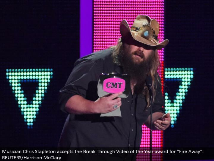 "Musician Chris Stapleton acknowledges the Break Through Video of the Year honor for ""Flame Away"". REUTERS/Harrison McClary"