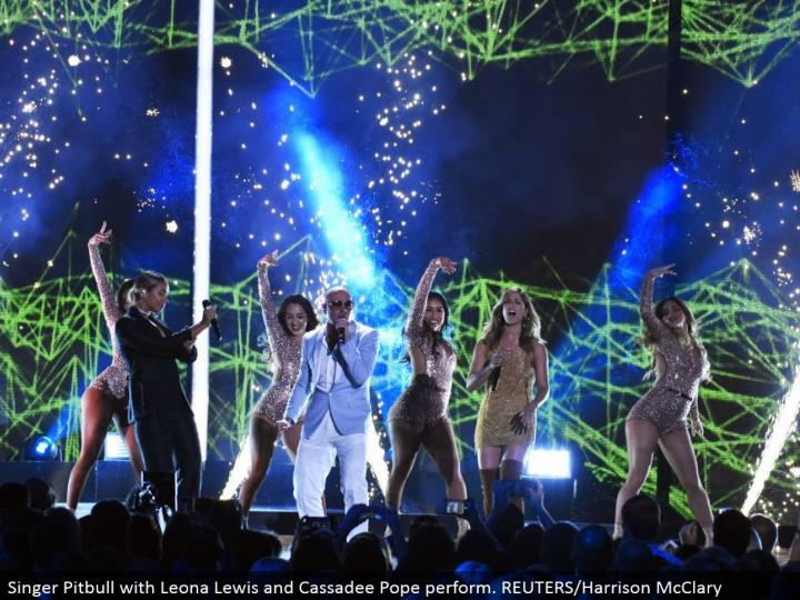 Singer Pitbull with Leona Lewis and Cassadee Pope perform. REUTERS/Harrison McClary
