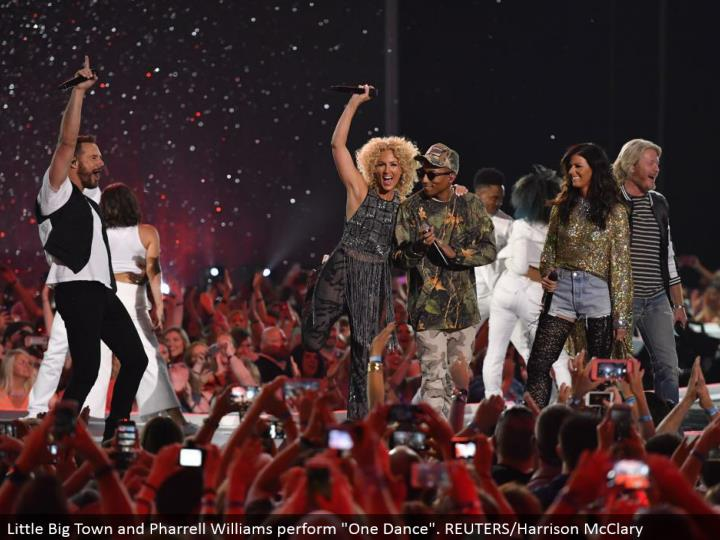"Little Big Town and Pharrell Williams perform ""One Dance"". REUTERS/Harrison McClary"