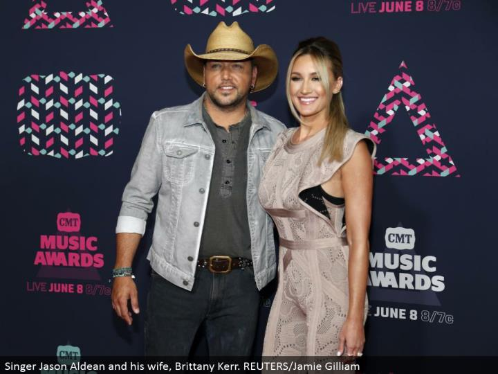 Singer Jason Aldean and his significant other, Brittany Kerr. REUTERS/Jamie Gilliam