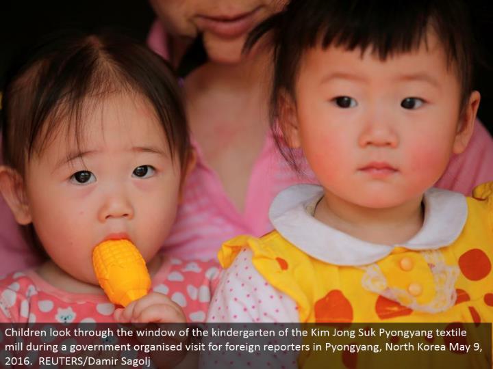 Children look through the window of the kindergarten of the Kim Jong Suk Pyongyang material plant amid a legislature composed visit for outside journalists in Pyongyang, North Korea May 9, 2016. REUTERS/Damir Sagolj