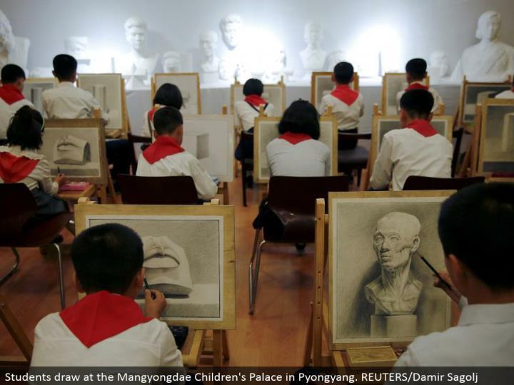 Students draw at the Mangyongdae Children's Palace in Pyongyang. REUTERS/Damir Sagolj
