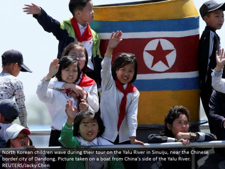 North Korean youngsters wave amid their visit on the Yalu River in Sinuiju, close to the Chinese outskirt city of Dandong. Picture tackled a watercraft from China's side of the Yalu River. REUTERS/Jacky Chen