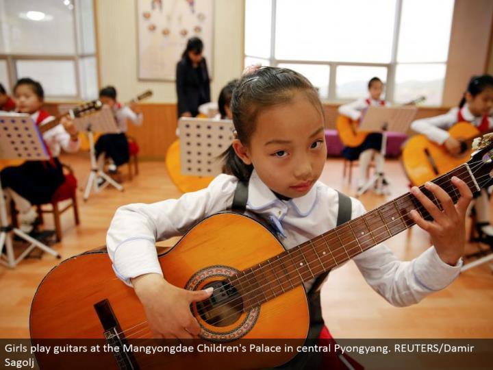 Girls play guitars at the Mangyongdae Children's Palace in focal Pyongyang. REUTERS/Damir Sagolj