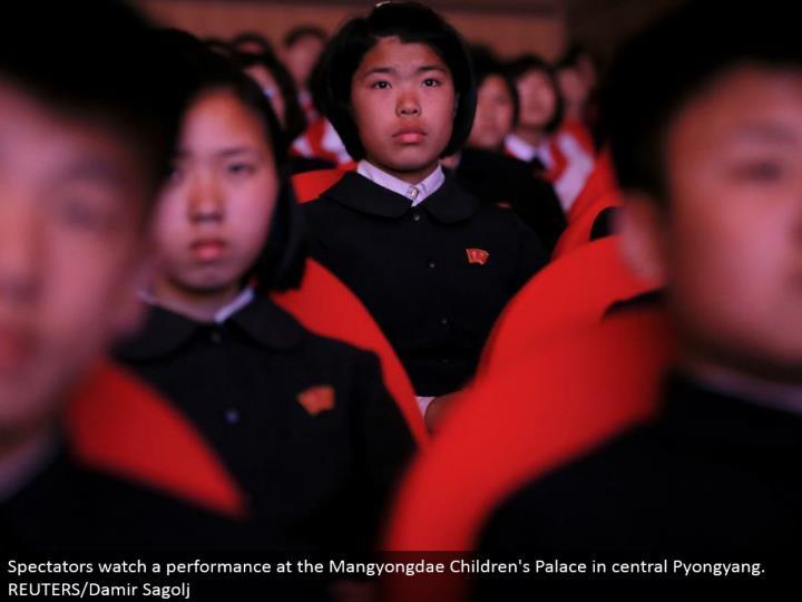 Spectators watch an execution at the Mangyongdae Children's Palace in focal Pyongyang.  REUTERS/Damir Sagolj