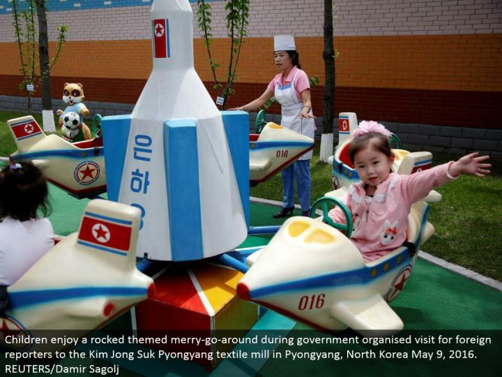 Children appreciate a shook themed joyful go-around amid government composed visit for remote journalists to the Kim Jong Suk Pyongyang material plant in Pyongyang, North Korea May 9, 2016. REUTERS/Damir Sagolj