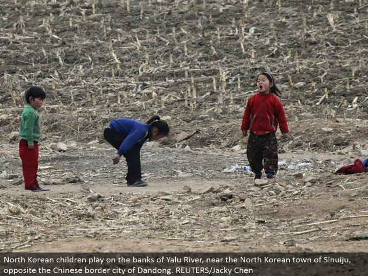 North Korean kids play on the banks of Yalu River, close to the North Korean town of Sinuiju, inverse the Chinese outskirt city of Dandong. REUTERS/Jacky Chen