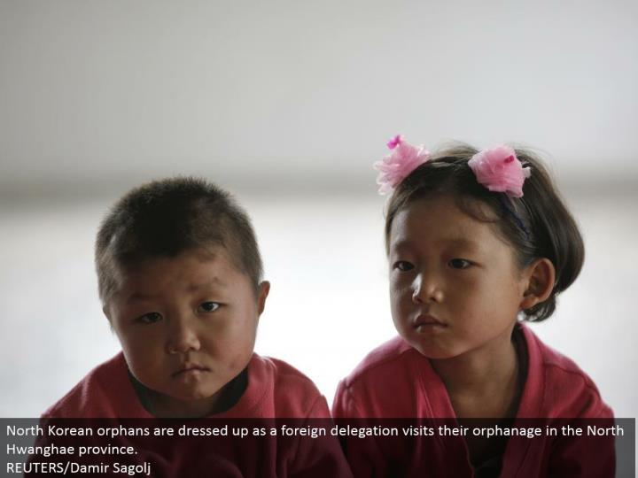 North Korean vagrants are spruced up as an outside designation visits their halfway house in the North Hwanghae territory.  REUTERS/Damir Sagolj