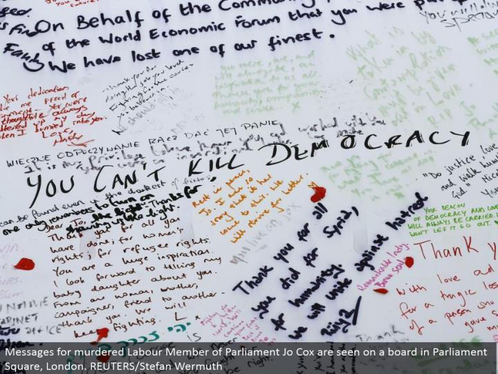 Messages for killed Labor Member of Parliament Jo Cox are seen on a board in Parliament Square, London. REUTERS/Stefan Wermuth