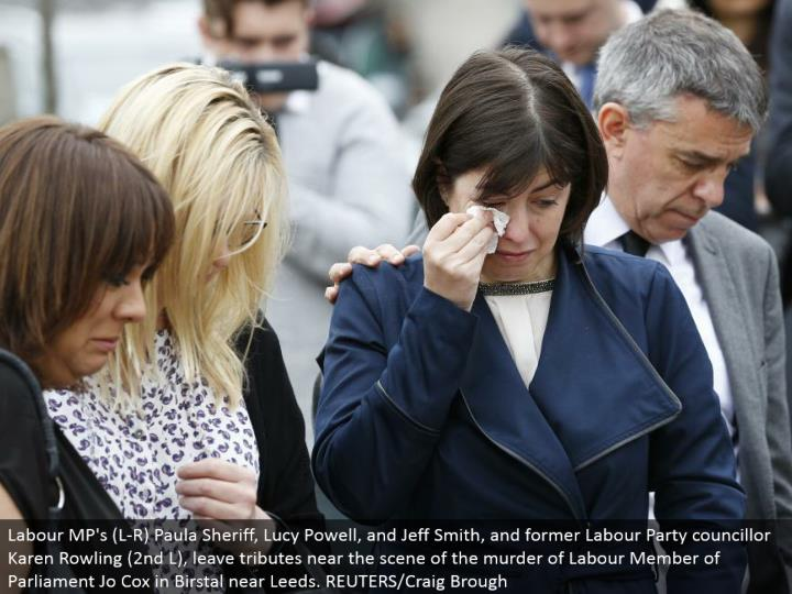 Labour MP's (L-R) Paula Sheriff, Lucy Powell, and Jeff Smith, and previous Labor Party councilor Karen Rowling (second L), leave tributes close to the scene of the homicide of Labor Member of Parliament Jo Cox in Birstal close Leeds. REUTERS/Craig Brough
