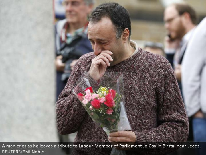 A man cries as he leaves a tribute to Labor Member of Parliament Jo Cox in Birstal close Leeds. REUTERS/Phil Noble
