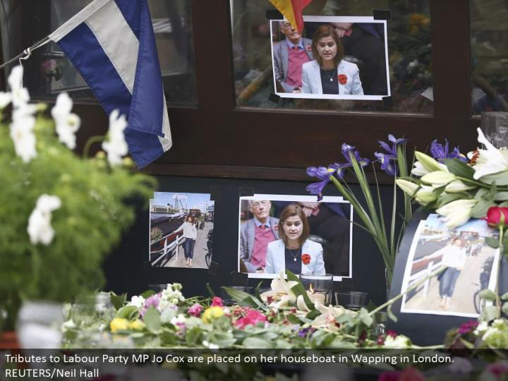 Tributes to Labor Party MP Jo Cox are set on her houseboat in Wapping in London. REUTERS/Neil Hall