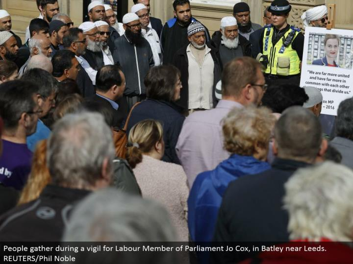 People assemble amid a vigil for Labor Member of Parliament Jo Cox, in Batley close Leeds. REUTERS/Phil Noble