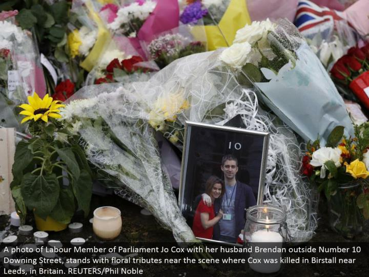 A photograph of Labor Member of Parliament Jo Cox with her significant other Brendan outside Number 10 Downing Street, remains with botanical tributes close to the scene where Cox was murdered in Birstall close Leeds, in Britain. REUTERS/Phil Noble