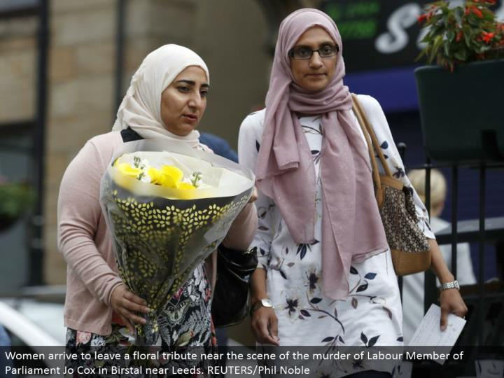 Women land to leave a botanical tribute close to the scene of the homicide of Labor Member of Parliament Jo Cox in Birstal close Leeds. REUTERS/Phil Noble
