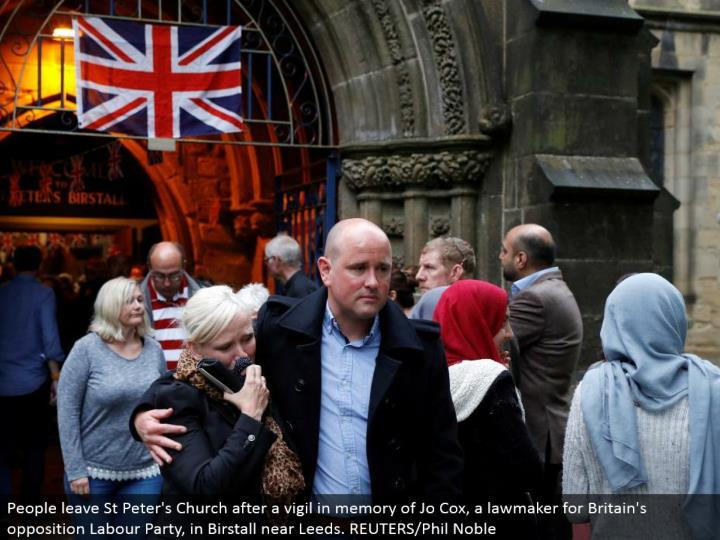 People leave St Peter's Church after a vigil in memory of Jo Cox, an official for Britain's restriction Labor Party, in Birstall close Leeds. REUTERS/Phil Noble
