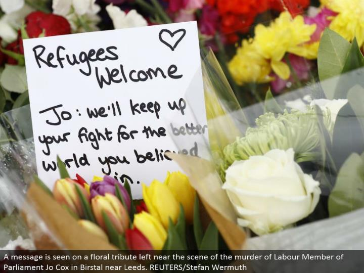 A message is seen on a botanical tribute left close to the scene of the homicide of Labor Member of Parliament Jo Cox in Birstal close Leeds. REUTERS/Stefan Wermuth