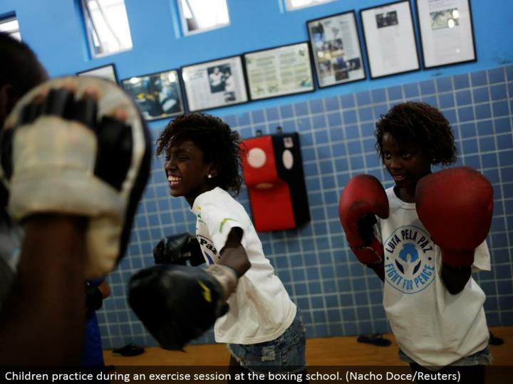 Children work on amid an activity session at the boxing school. (Nacho Doce/Reuters)