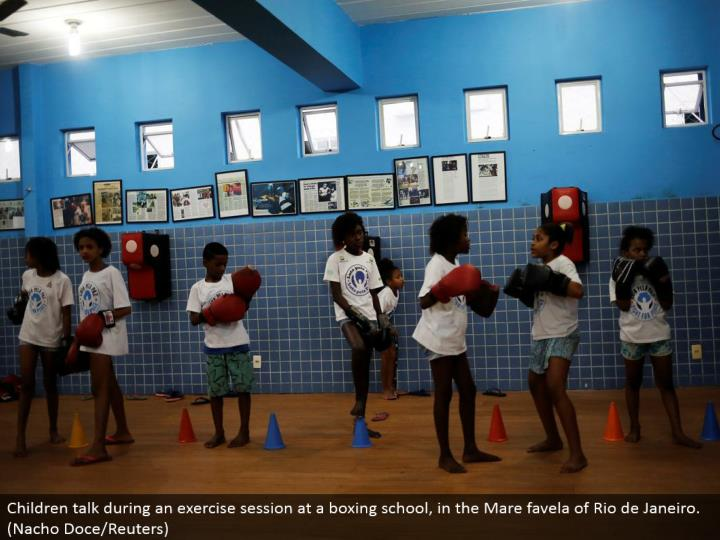 Children talk amid an activity session at a boxing school, in the Mare favela of Rio de Janeiro. (Nacho Doce/Reuters)