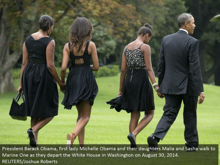 President Barack Obama, first woman Michelle Obama and their little girls Malia and Sasha stroll to Marine One as they withdraw the White House in Washington on August 30, 2014. REUTERS/Joshua Roberts