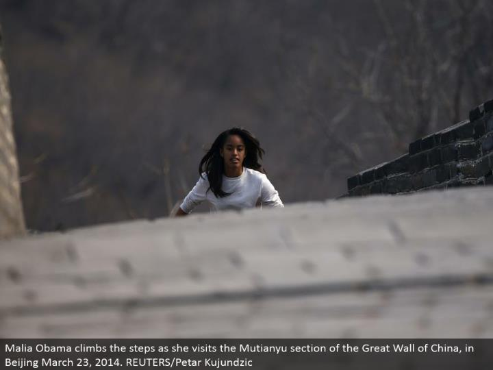 Malia Obama climbs the progressions as she visits the Mutianyu segment of the Great Wall of China, in Beijing March 23, 2014. REUTERS/Petar Kujundzic