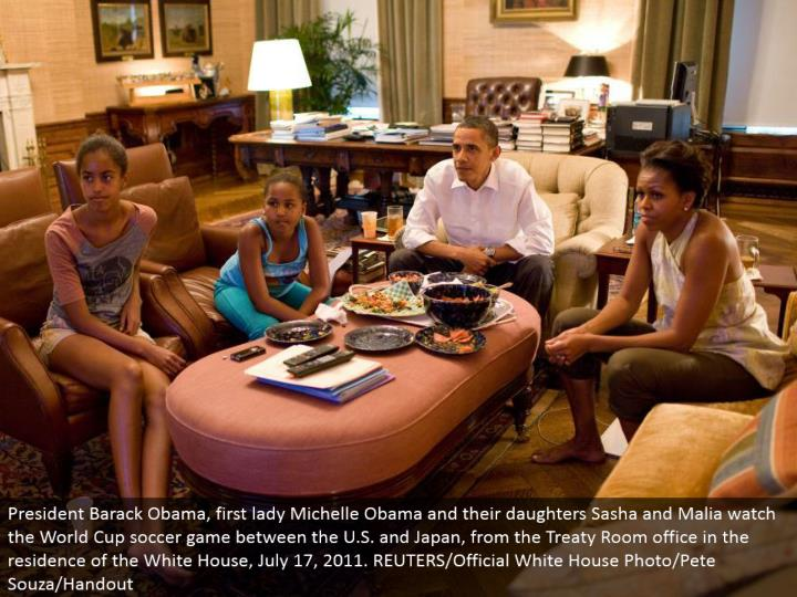 President Barack Obama, first woman Michelle Obama and their little girls Sasha and Malia watch the World Cup soccer match between the U.S. what's more, Japan, from the Treaty Room office in the living arrangement of the White House, July 17, 2011. REUTERS/Official White House Photo/Pete Souza/Handout