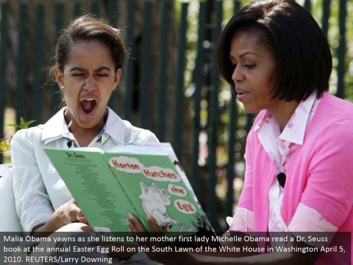 Malia Obama yawns as she listens to her mom first woman Michelle Obama read a Dr. Seuss book at the yearly Easter Egg Roll on the South Lawn of the White House in Washington April 5, 2010. REUTERS/Larry Downing